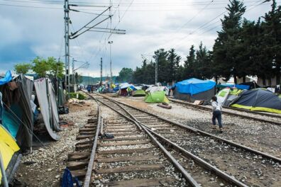 <p><strong>Tents and flimsy shelters hug the railway tracks</strong><br />Idomeni, Northern Greece 2016</p>