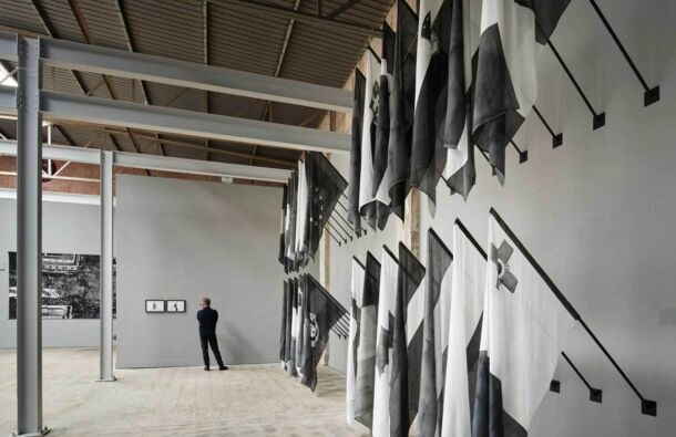 <p>Installation view of <em>Dark Europe</em>, 29 Flags (Silk 90cm x 165cm ) Wall mounted 90 degree steel flag poles (180cm) and fixing.</p>