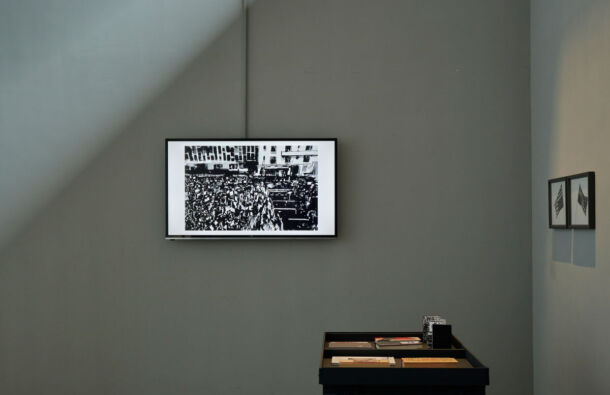 <p>Installation view of screen and research table. Precarious Freedom at the Festival Gallery; 1-18 September 2021</p>